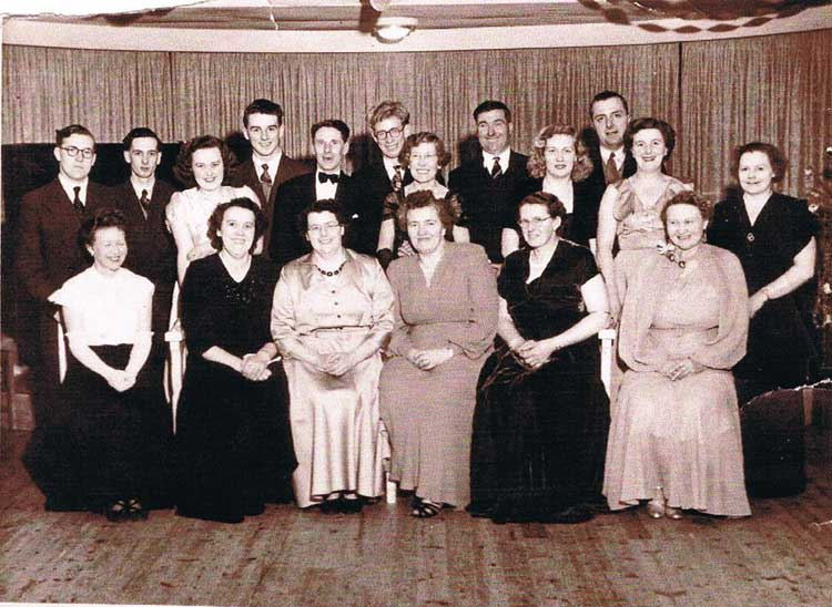 East Prawle Drama or Choir Group, Mrs Thorpe far right, Dorothy Tripp next to her, Mrs Logan in the middle, unknown, Diana Thorpe (Shelvoke) far left, far back top right Jack Rendell, in front of him his wife Dorothy