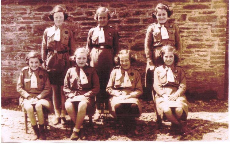 Girl Guides: Back row from left: Patsy Putt, Nancy Login, Rita Rundle; Front Row: Elsie Login, Unknown, Barbara Partridge, Queenie Weymouth, 1930s